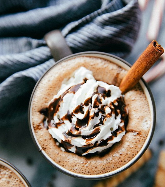 hot chocolate with whipped cream and drizzle