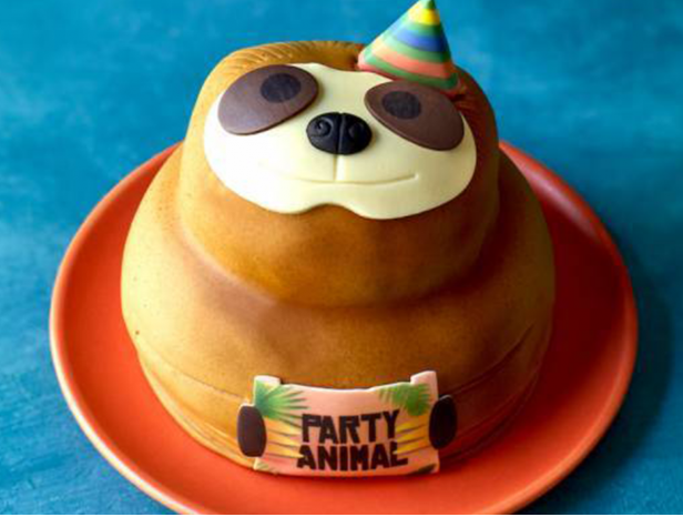 sloth birthday cake with party hat