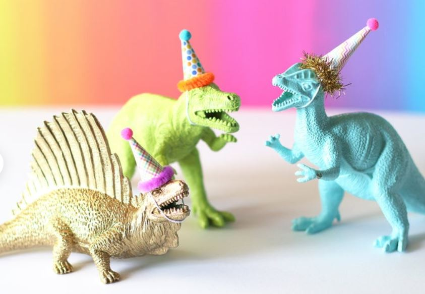dinosaur with party hats